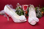 foto of wench  - white weddin shoes on a red background - JPG