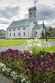 foto of evangelism  - View across flower borders of the Evangelical Lutheran Church of Iceland in the capital - JPG
