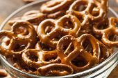 stock photo of pretzels  - Organic Brown Mini Pretzels with Salt in a Bowl - JPG
