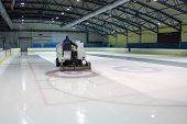 stock photo of hockey arena  - ice resurfacer clean ice in skating rink - JPG