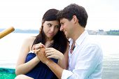 stock photo of forgiveness  - Woman forgiving smiling husband in vacation in Italy - JPG