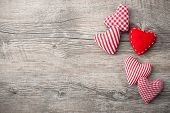 picture of wood design  - Valentines Day background with patterned textile hearts on old wooden - JPG