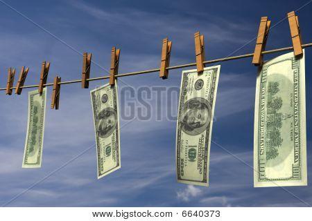 Hundred dollar bills hanging on a clothesline