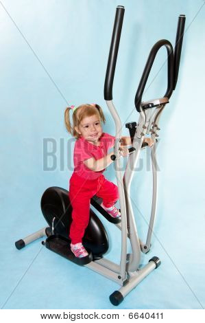 Little girl in a sports simulator.