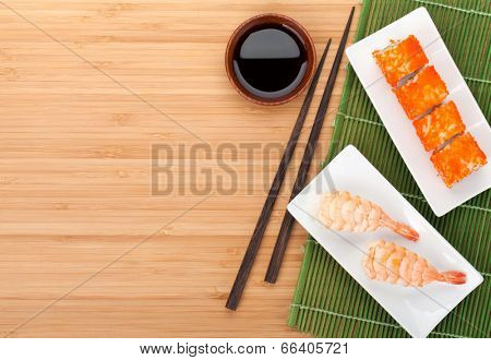 Sushi maki and shrimp sushi on bamboo table with copy space