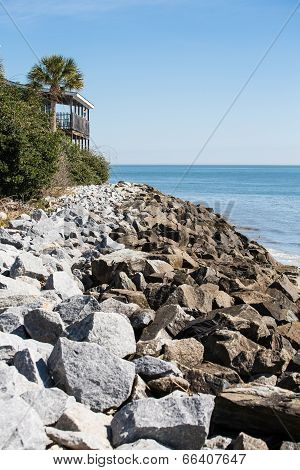 Rock Seawall And Deck Of Coastal Home
