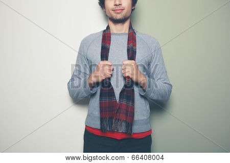 Young Man With A Scarf Against Split Colored Background