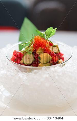 Tuna and avocado tartare served on ice