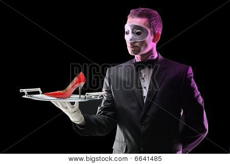 Butler with a mask holding a tray