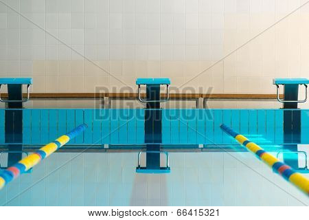 Starting blocks and lanes in a swimming pool