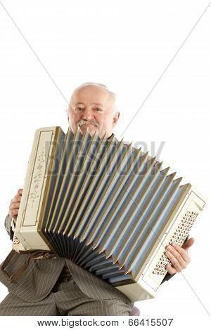 Old harmonica player