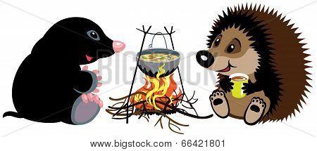mole and hedgehog near campfire