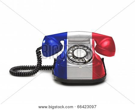 Office: Old And Vintage Telephone With The French Flag