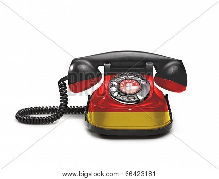 Office: Old And Vintage Telephone With The Germany Flag