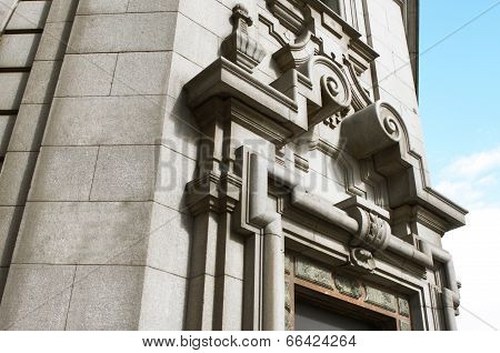 Neoclassic Stone Building Facade With In Grey Color