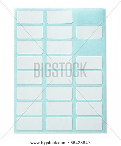 Partially used white labeling stickers with blue backing sheet, isolated on white.