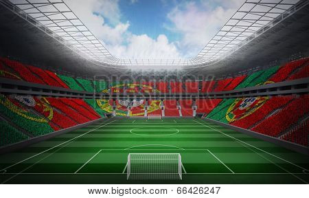 Digitally generated portugese national flag against football stadium