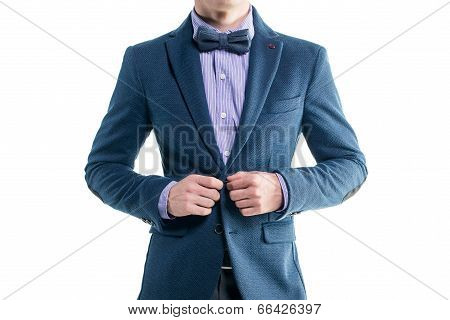 Handsome elegant young fashion man in coat tuxedo classical suit costume and bow tie isolated on whi