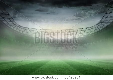 Digitally generated misty football stadium under spotlights