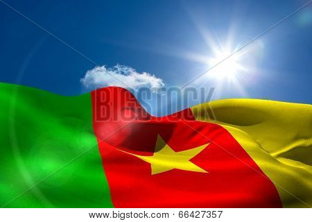 Digitally generated cameroon national flag under sunny sky