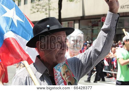 Elder man with Oscar Javier Lopez literature