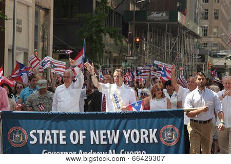 NY Governor Andrew Cuomo with banner