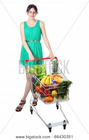 Woman In Green Dress With Full Shopping Grocery Cart