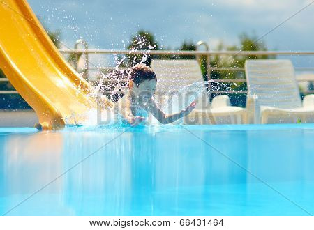 Cute Boy Kid Having Fun On Water Slide