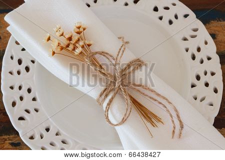 Serviette With Dried Flowers On White Plate