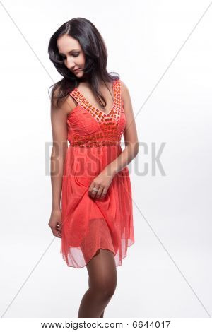 sexual dark haired girl in peachy dress feel shy isolated