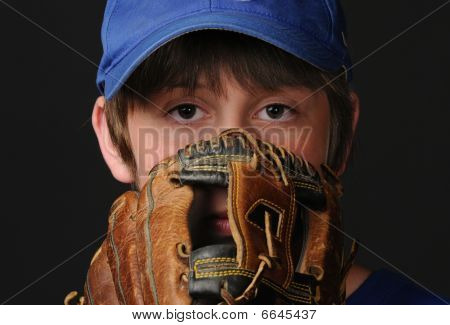 Young boy prepares to pitch baseball