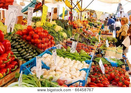 People Near A Counter With Vegetables On A Market In Venice, Italy