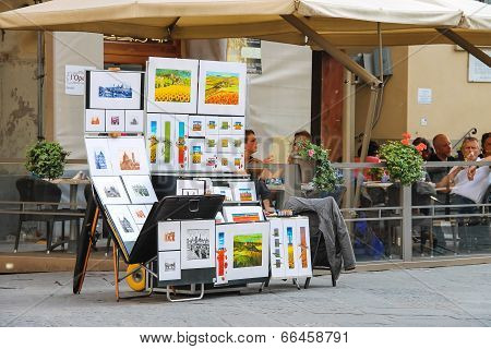 Equipment And Drawings Street Artist Outside Restaurant In Florence, Italy
