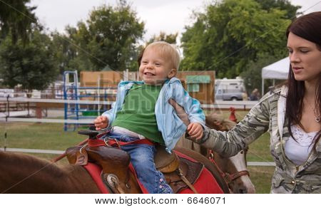 Toddler On First Pony Ride