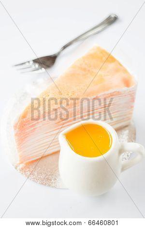 Orange Whipped Cream Crepe Cake On White Background