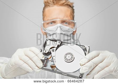 Man Technician Shows The Hard Disk