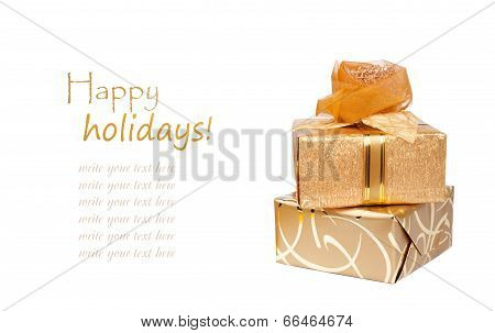 Beautiful Gift Boxes In Gold Paper With A Silk Rose Isolated On A White Background
