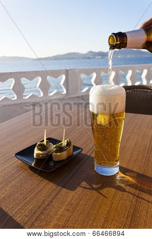 Pouring Beer In A Glass Near The Sea.