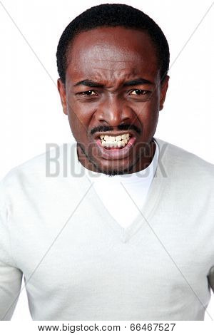Portrait of angry african man isolated on white background