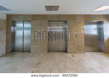 Modern elevators with closed doors