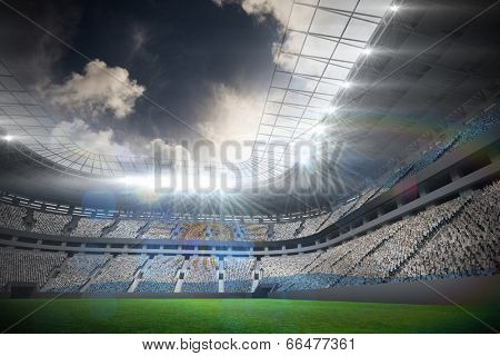 Argentinian flag against football stadium with fans in white
