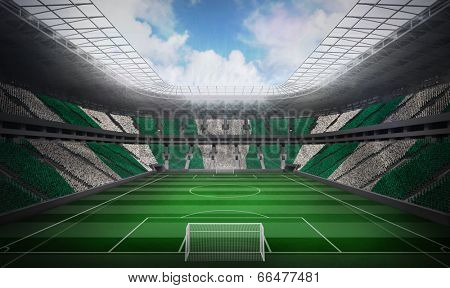 Digitally generated nigerian national flag against football stadium