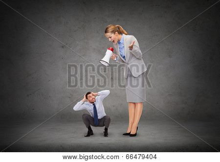 business, communication and office concept - angry businesswoman with megaphone screaming at businessman
