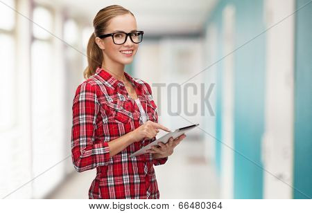 technology, internet, education and people concept - smiling girl in eyeglasses with tablet pc computer at school corridor