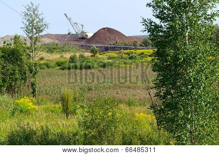 The Natural Landscape Near Dump And Excavator