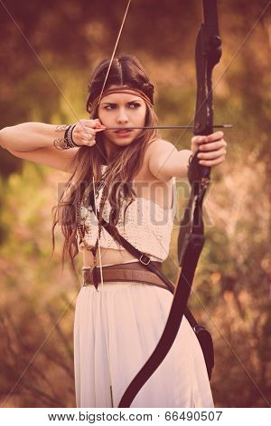 woodland hunter woman with bow and arrow