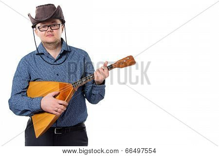 Man with balalaika in cowboy hat
