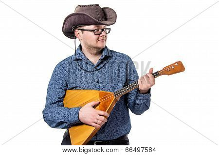 Man with balalaika in stetson