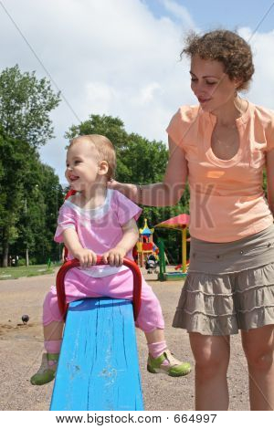 Baby  On Seesaw With Mother