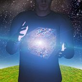 stock photo of levitation  - Man magically levitates abstract box - JPG